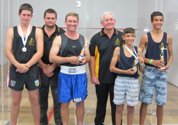 Boxers with their trophies and medals.